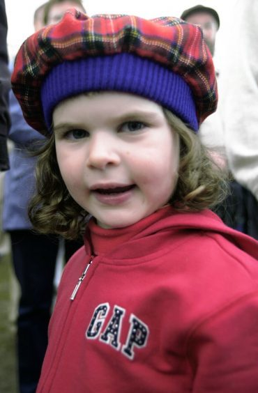 Daisy Dryden Thomas from Oxfordshire models her Scottish hat in 2002
