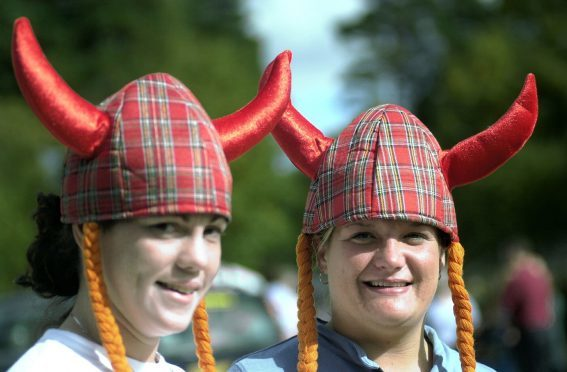 Louise Brisley and Vicky Walton from Salisbury with their Viking hats in 2003.