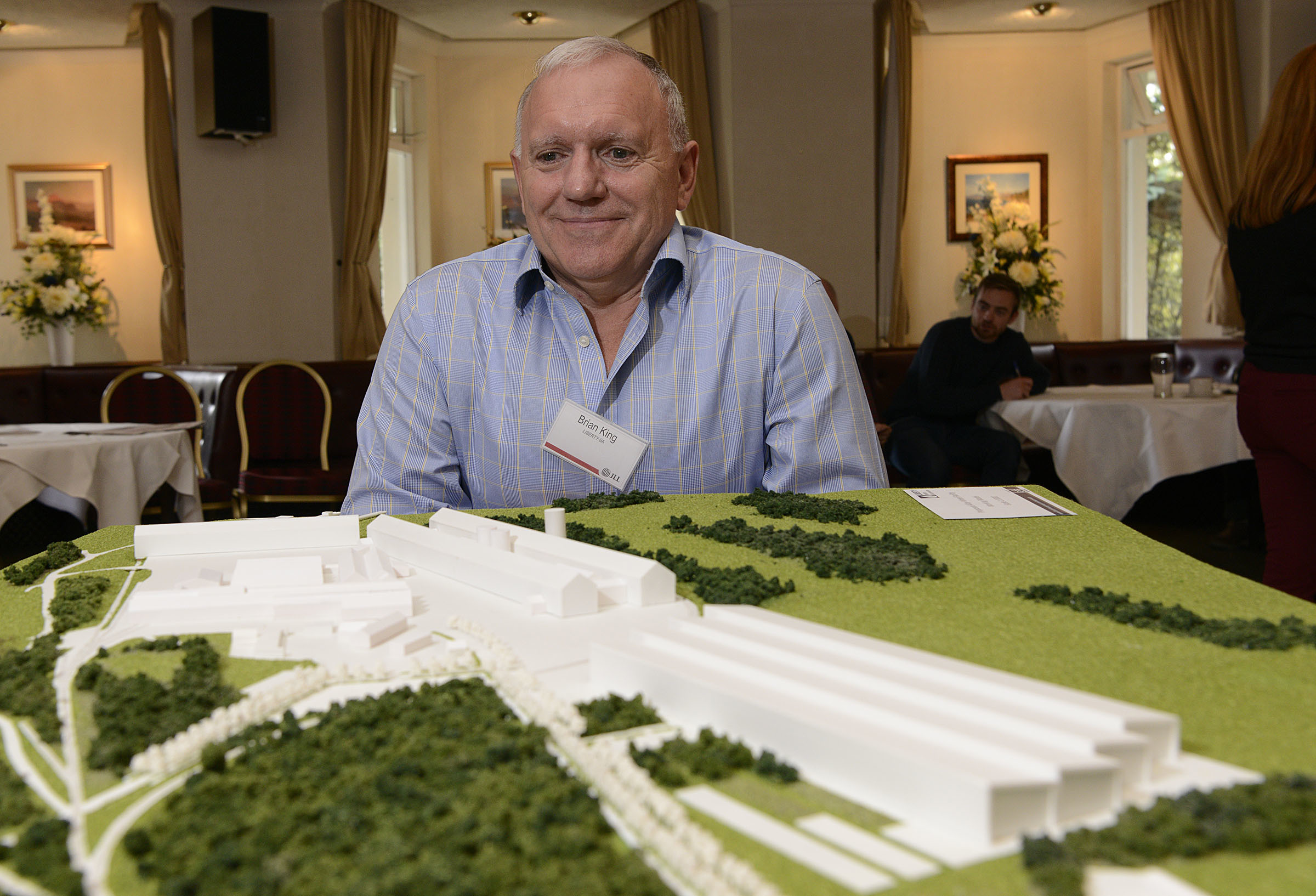 Smelter Director, Brian King with the 3D model of the proposed new factory.
