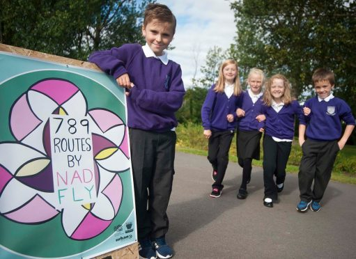 Seafield Primary School pupil Alfie Forbes helps launch the new Nadfly walking route. Pictured rear, from left: Bethany Muir, Jamie-Leigh Murdoch, Kelsie Sangster, Matthew Rooney.