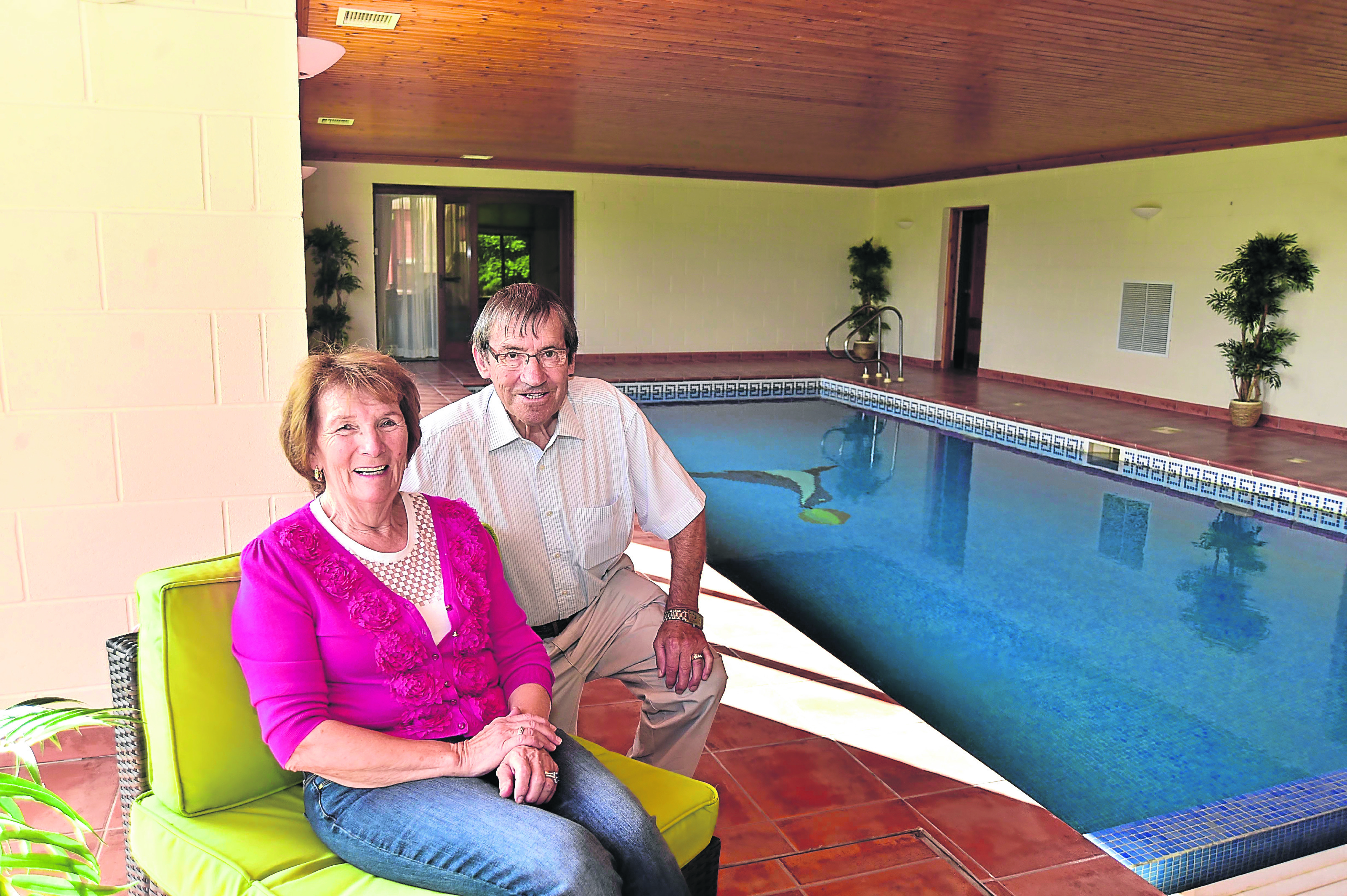 James and Marie Sutherland by the indoor pool
