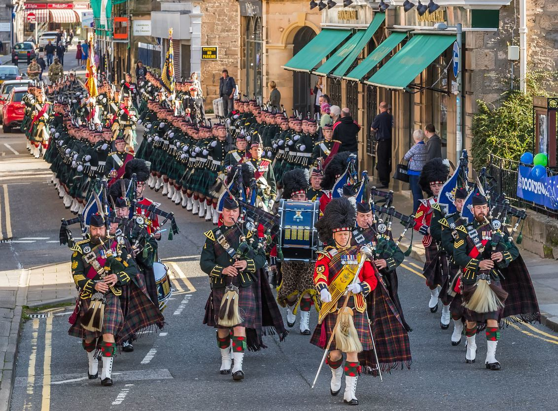 4 Scots marching down Elgin's South Street.
