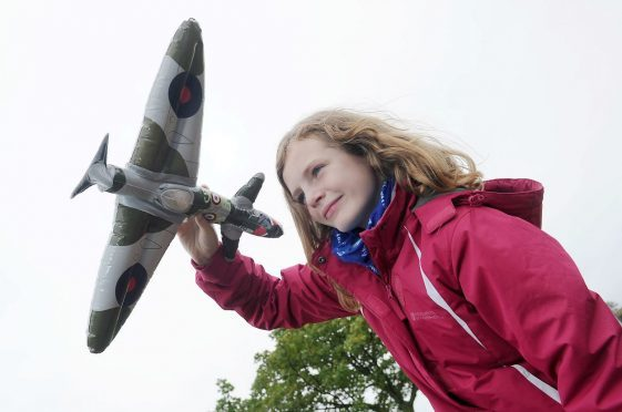 Bishopmill Primary School pupil Amy Simpson learning about flight at RAF Lossiemouth.