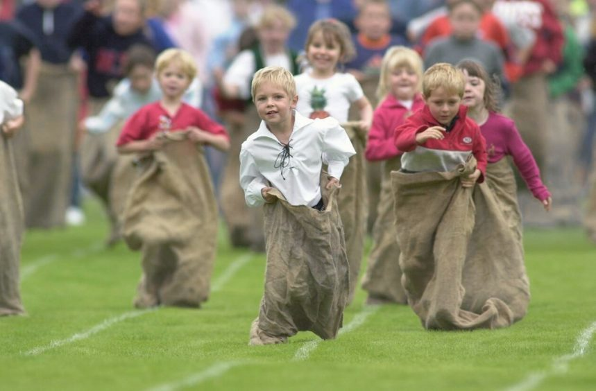 Children compete in the sack race in 2001