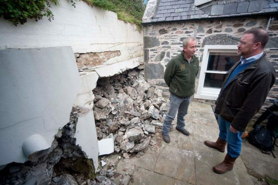 David Duguid inspects damage at Sandend following the landslip.