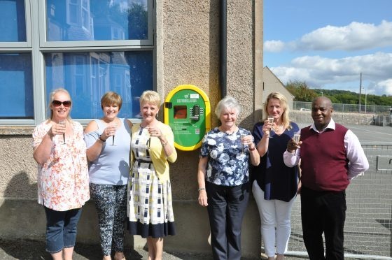The Keig defibrillator group toast the new addition - (L-R) - Yvonne Buckingham, Diane Forbes, Celia Williams, Etta Kellock,                                           Rosie Marshall and Rory Williams