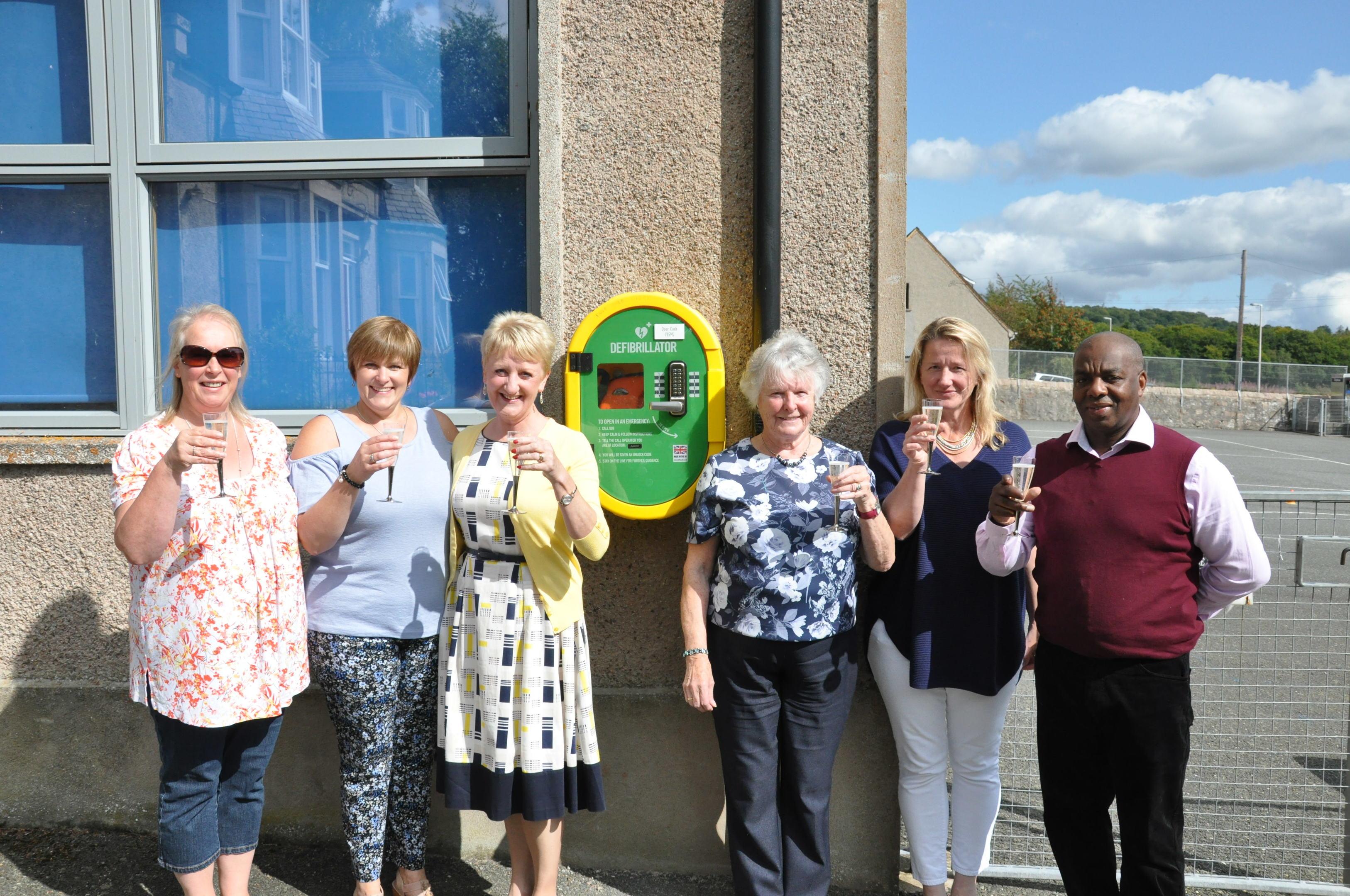 The Keig defibrillator group toast the new addition - (L-R) - Yvonne Buckingham, Diane Forbes, Celia Williams, Etta Kellock,                                           Rosie Marshall and Rory Williams