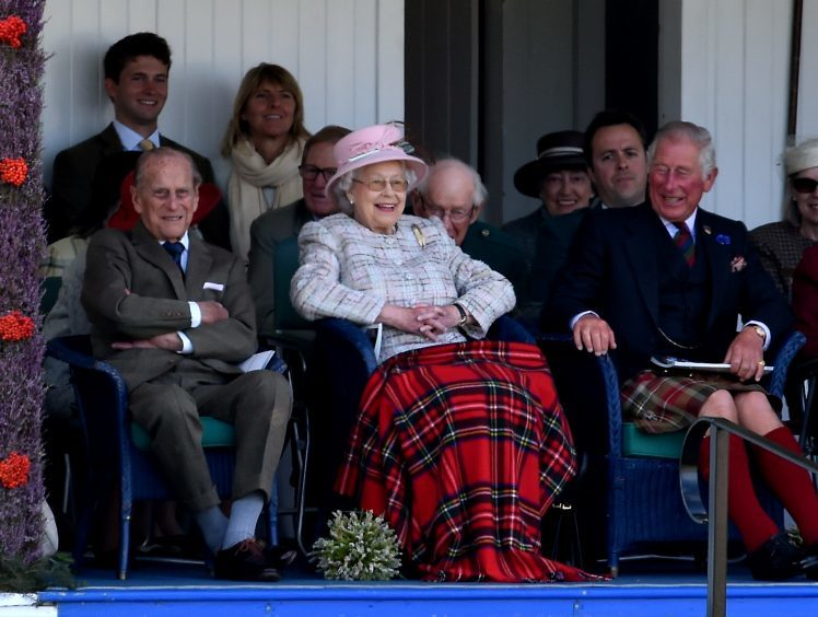 Prince Philip, the Queen and Prince Charles enjoy the games