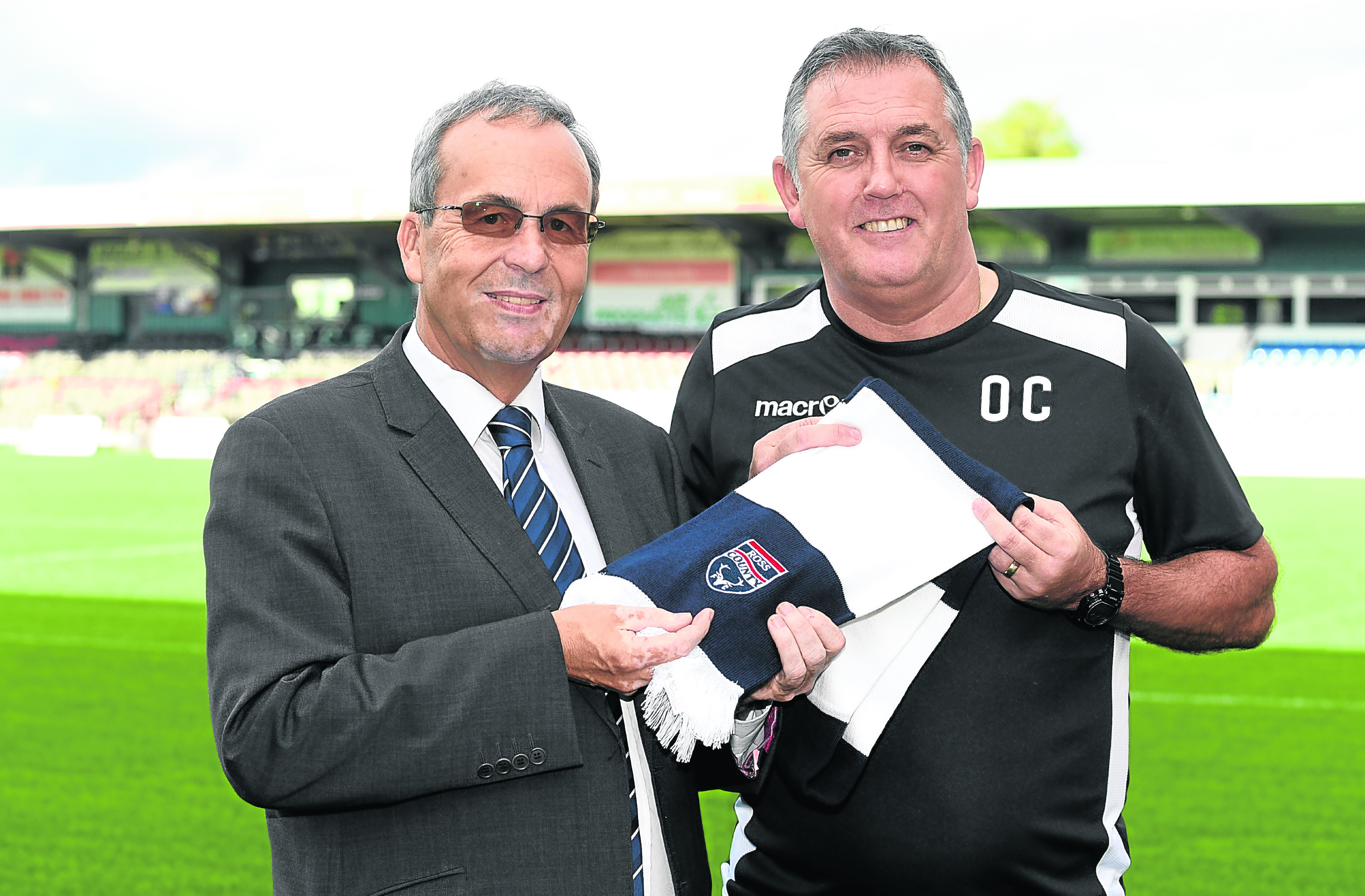 Owen Coyle meets the press as he is unveiled as Ross County's new manager, alongside chairman Roy McGregor (left)