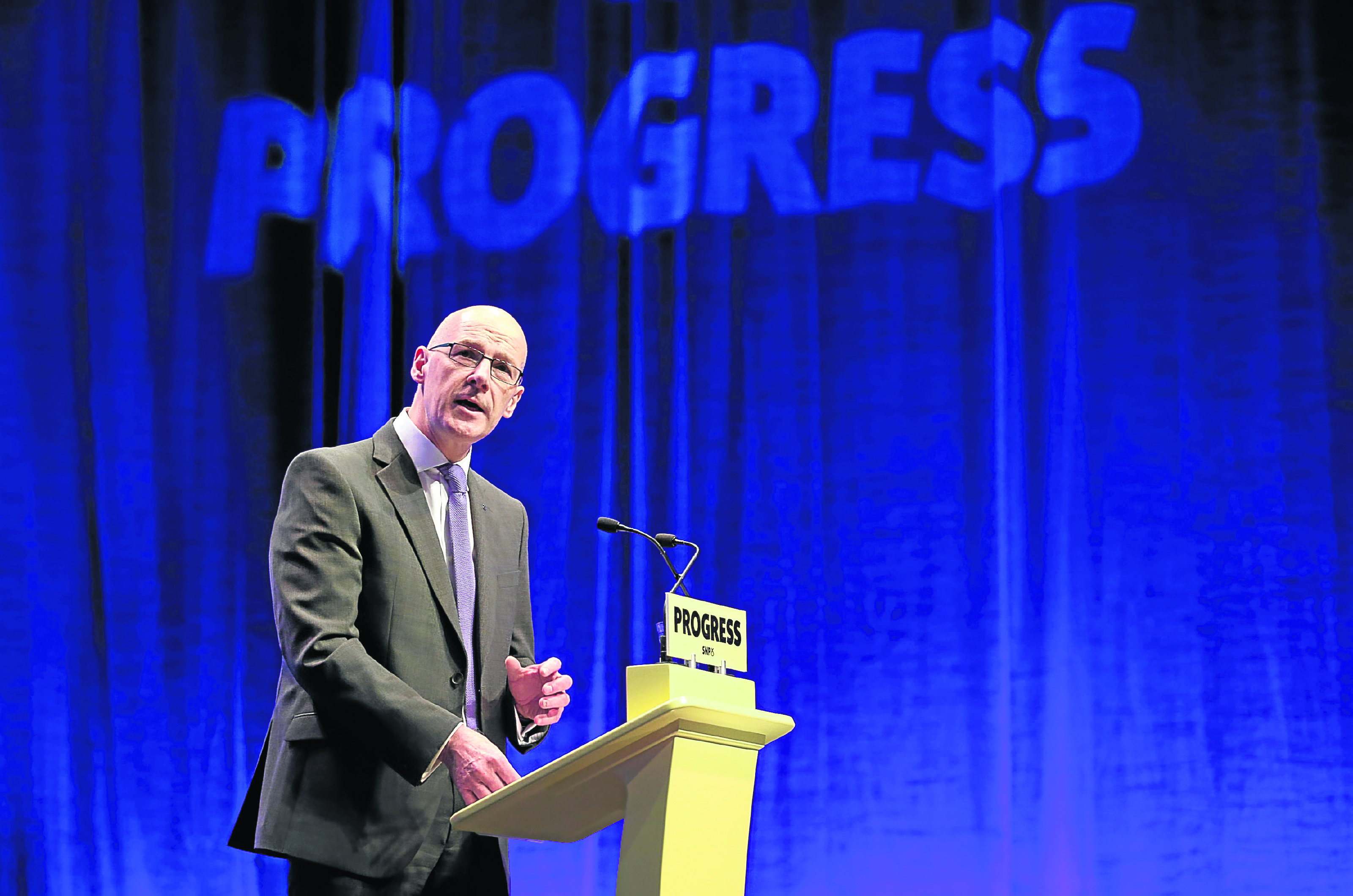 Deputy First Minister of Scotland John Swinney delivers the opening address to delegates at the  Scottish National Party (SNP) conference at the SEC Centre in Glasgow.