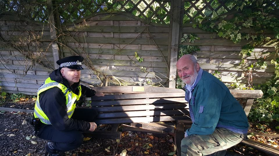 Constable Andrew Shepherd with community volunteer Harry Hansen with one of the damaged benches.