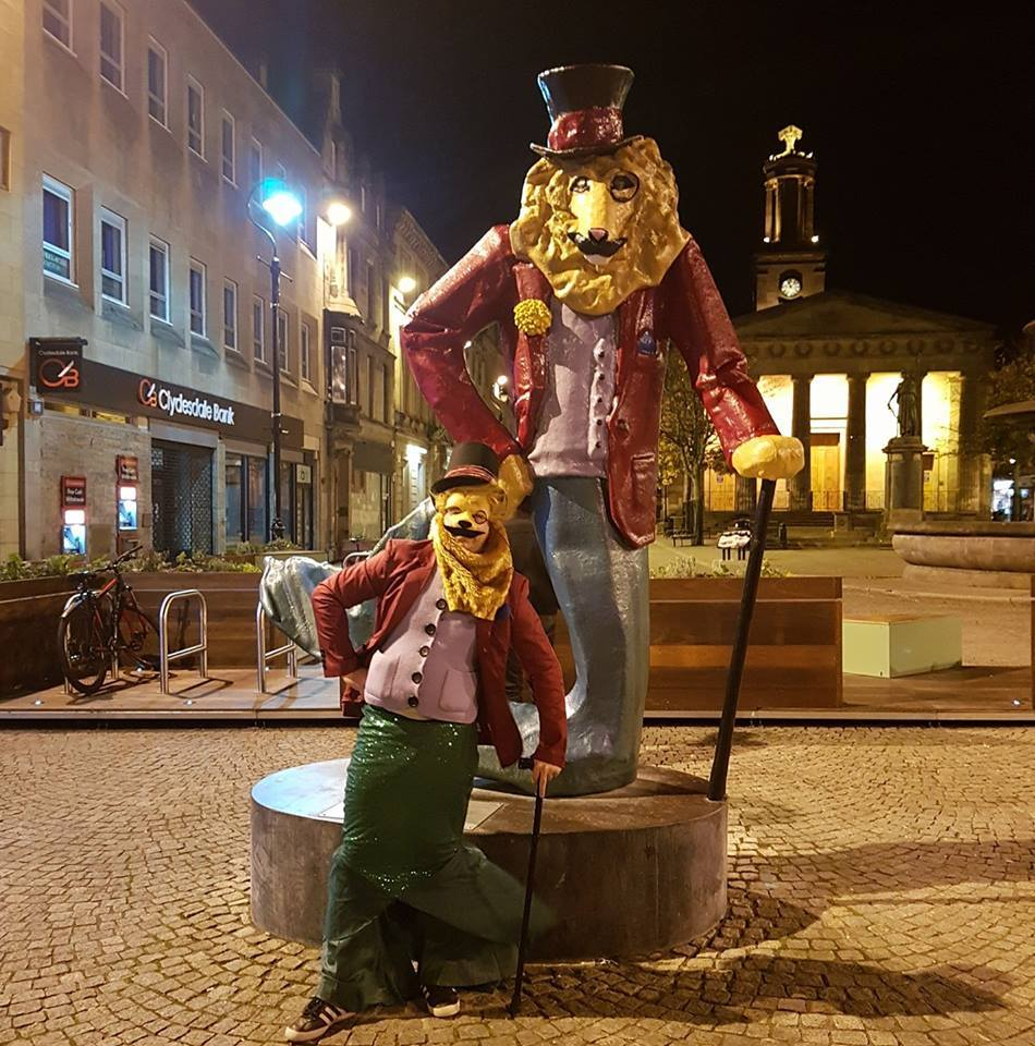 Johnny Kessack poses with the real Dandy Lion in Elgin
