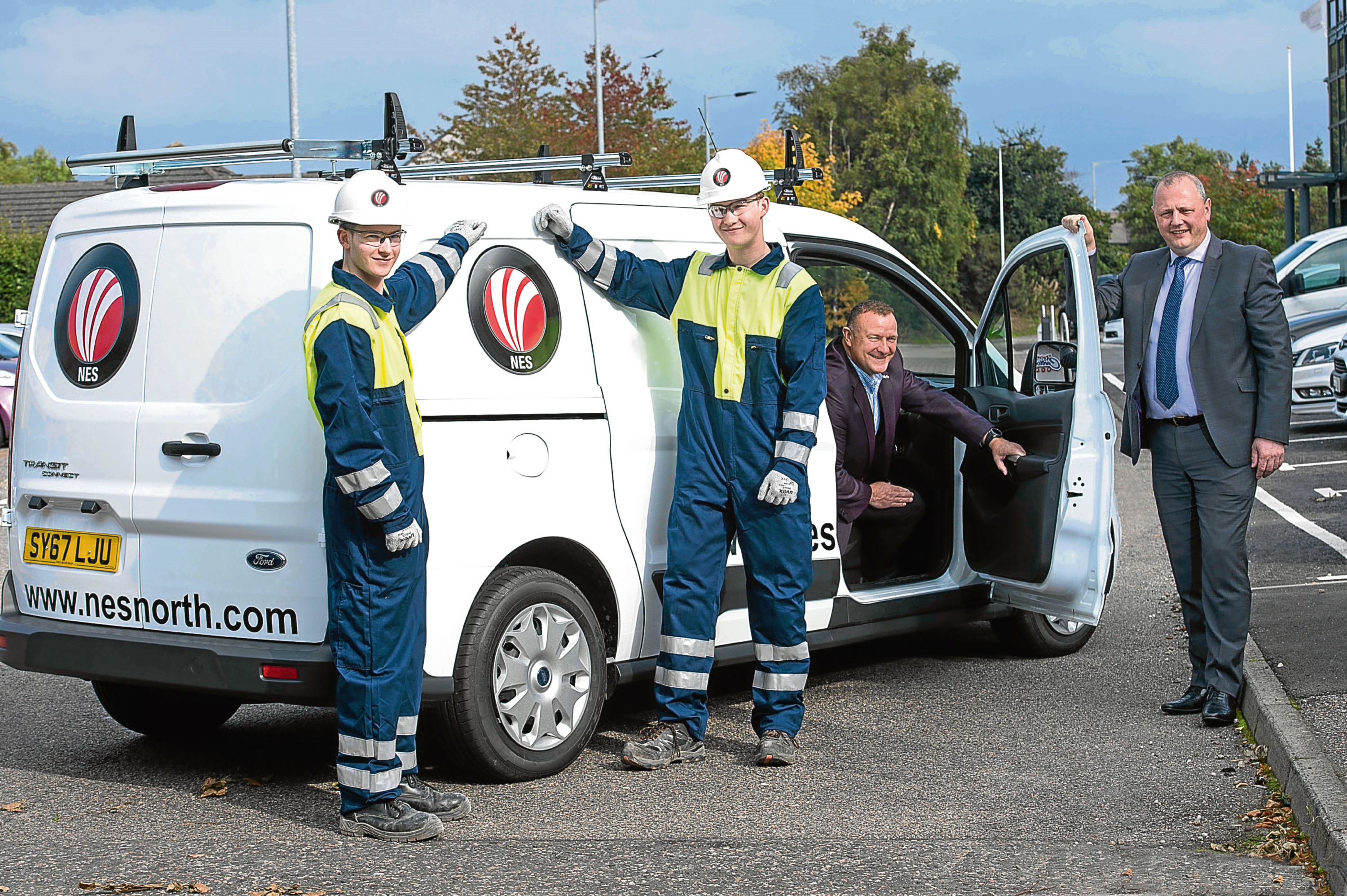Drew Hendry MP with Kenny Duncan, NES managing director with  Apprentices  Tyler Whitty (17) and Kyle Livingstone (18)