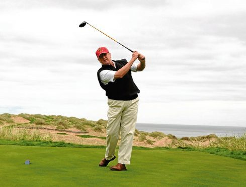 Donald Trump visiting the site of his golf course on  Aberdeenshire's coast in 2009.