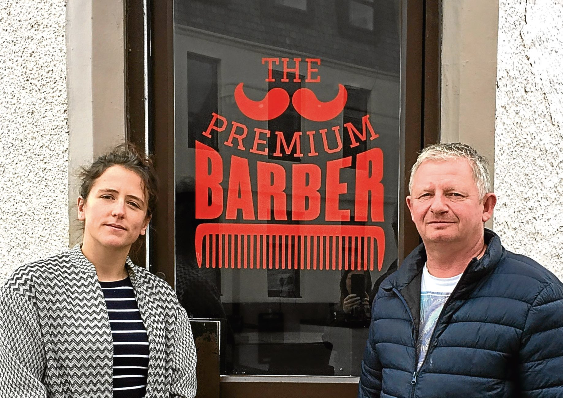 Businessman Andrew Bruce with Mairi Gougeon MSP outside his Stonehaven barbers shop