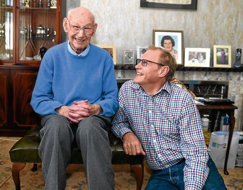 George Whyte, 95, Inverurie, is part of a volunteer scheme  and is pictured with volunteer, Mark Johnson.   Picture by Jim Irvine