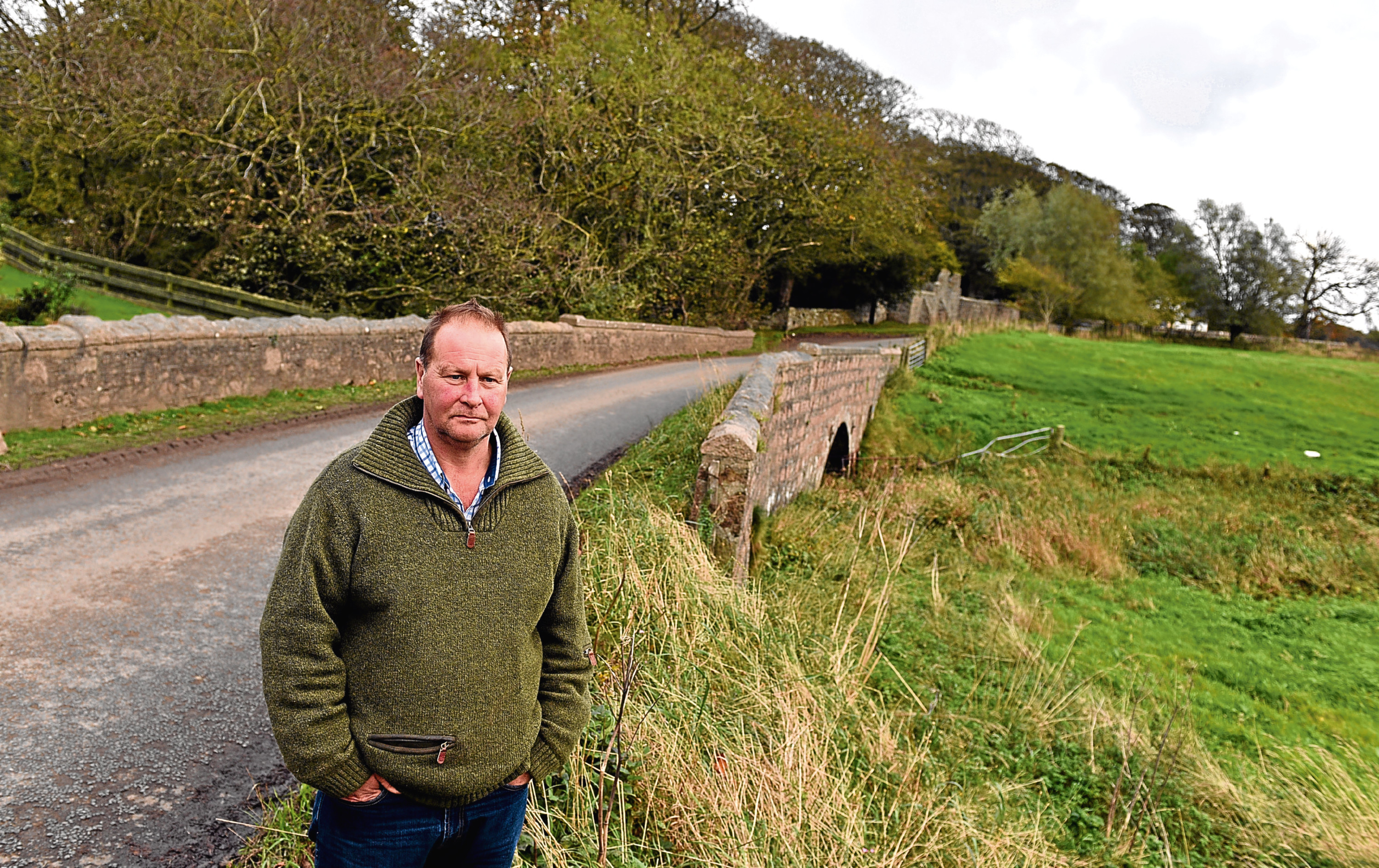 Local farmer James Duthie is concerned about the possible damage to Piergersie Bridge near Foveran Church which is on the diversion route to the village, due to the AWPR work. Picture by Kami Thomson