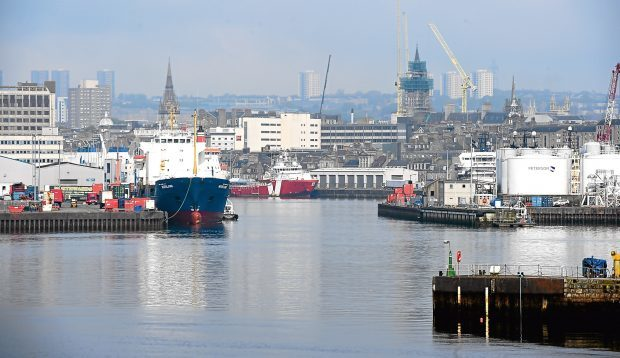 Aberdeen Harbour.     Picture by Kami Thomson    18-05-16    general view oil gas insustry Town House skyline service boats ships