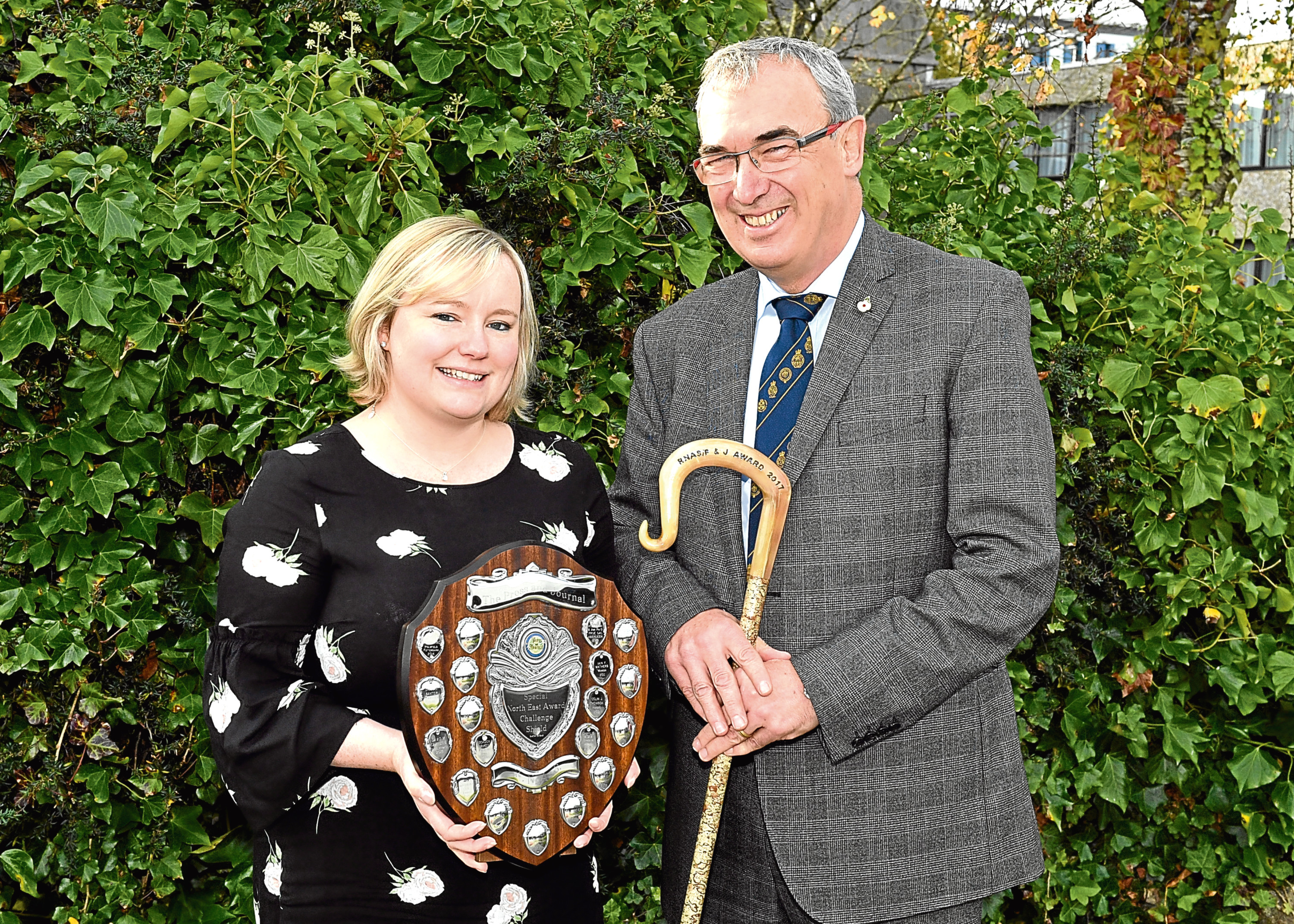 Press and Journal farming editor Gemma Mackenzie presents Pat Machray with his award