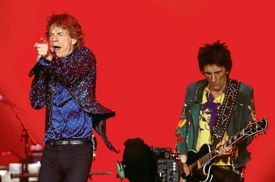 Mick Jagger of the Rolling Stones, left, and guitarist Ron Wood
