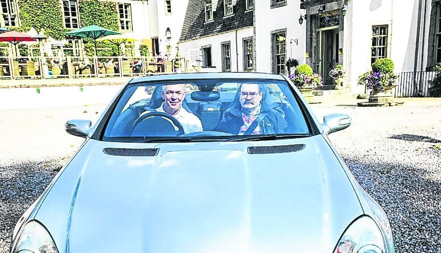 Stephen Morrison, who has multiple sclerosis and a passion for cars, was taken out for a drive in a Mercedes by Bryan Forman of local business Newmachar Motors.