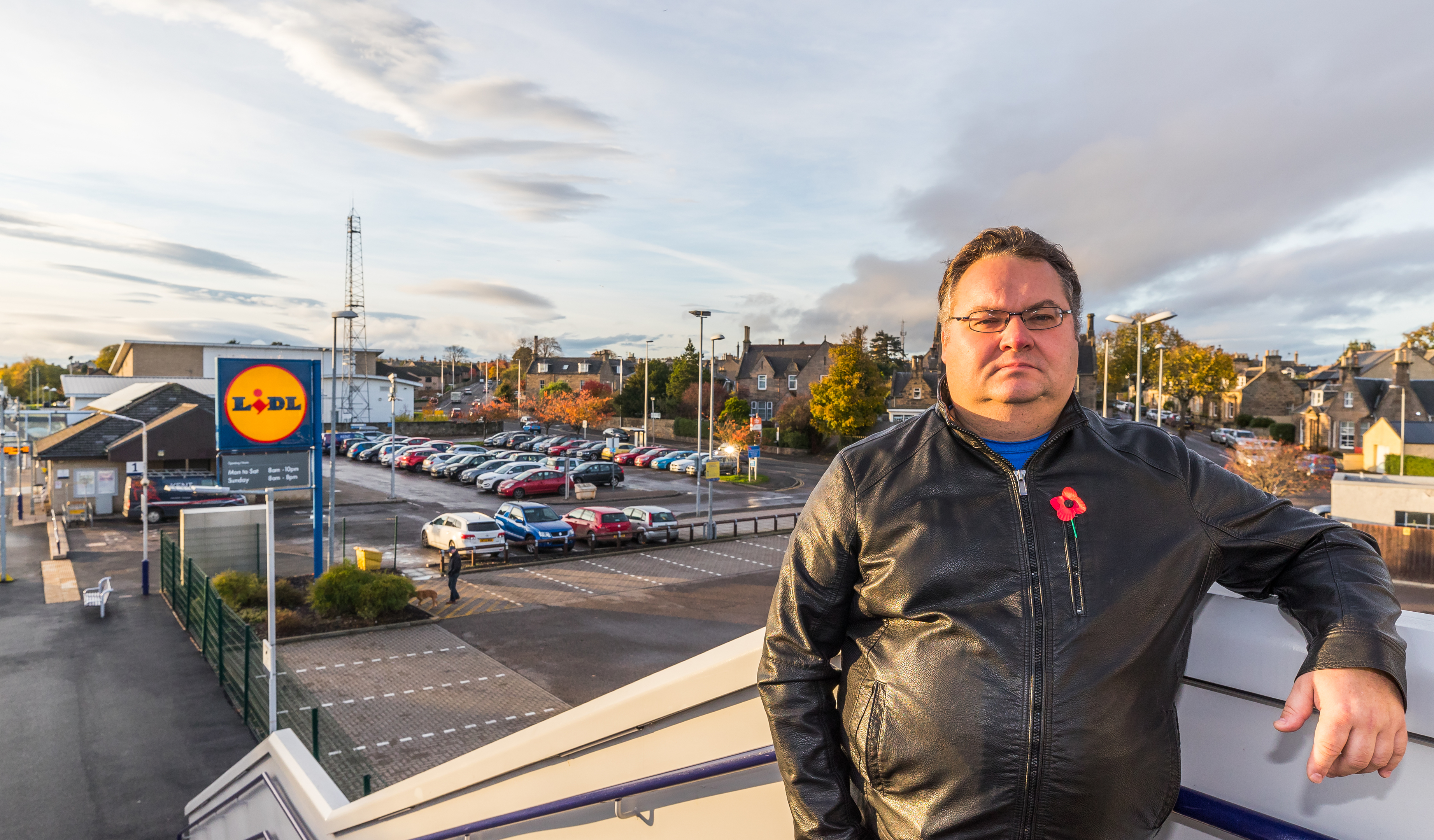 Councillor Graham Leadbitter overlooking the car park at Elgin's railway station