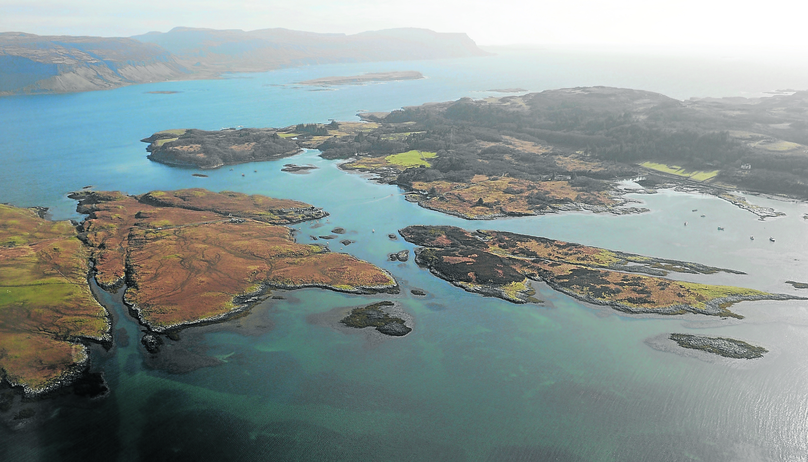 The island of Ulva, on the right, passed out of private ownership and into the hands of the local community.