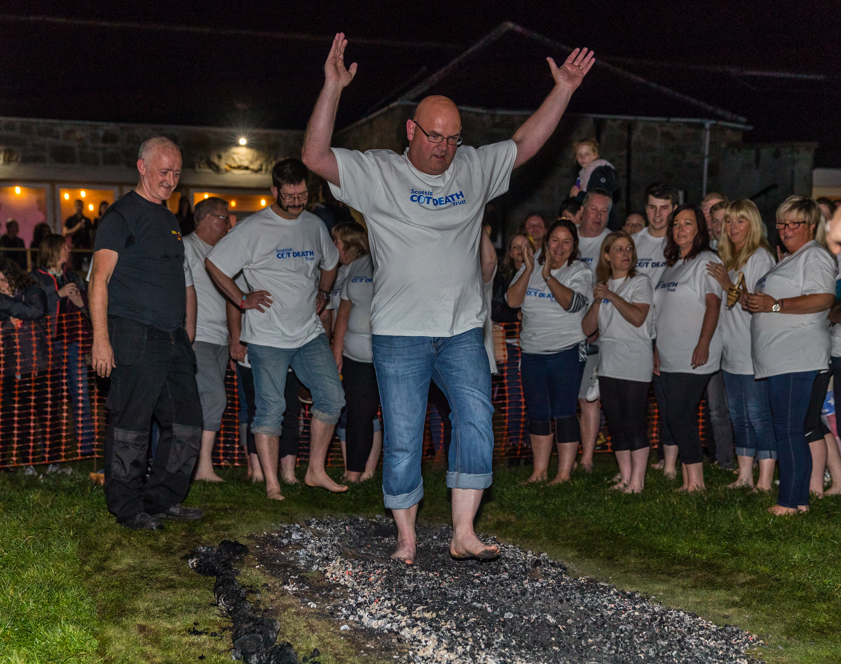 Residents walk the fire at Lossimouth in aid of Scottish Cot Death Trust.