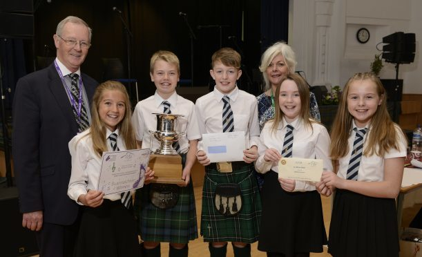 Councillor Allan Hendeson and Morag Anna Macleod of the Highland Council present the award to Dingwall singers (left - right)  Mhairi MacKenzie, Ruaraidh Drennan, Finlay MacLennan, Andrea MacDonald and Isabelle Rose.