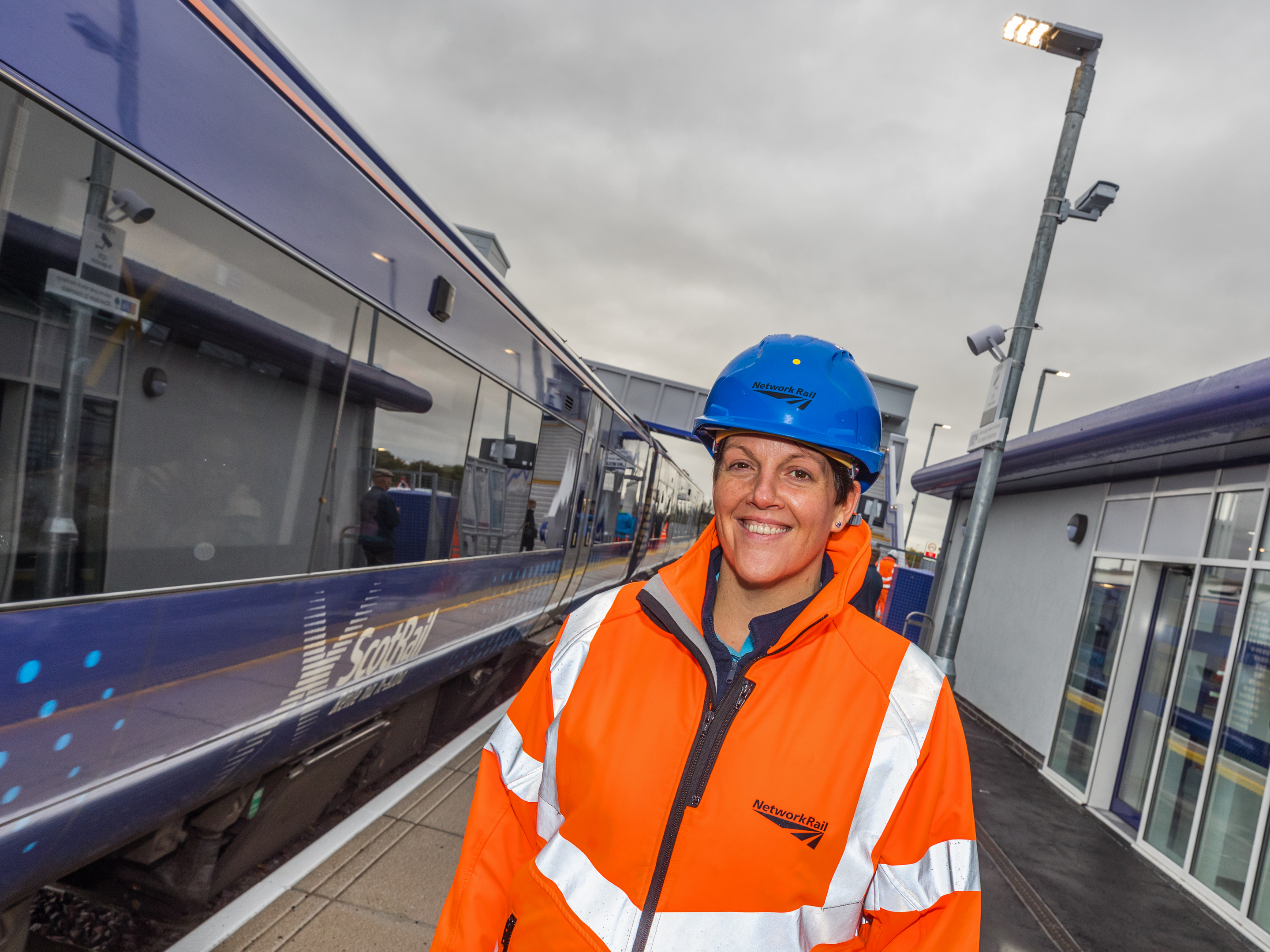 Network Rail's Stacey Macdonald welcomes the first services to the new train station in Forres.
