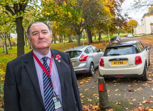 """Councillor John Divers fears parking in Elgin could be used as a """"cash cow""""."""