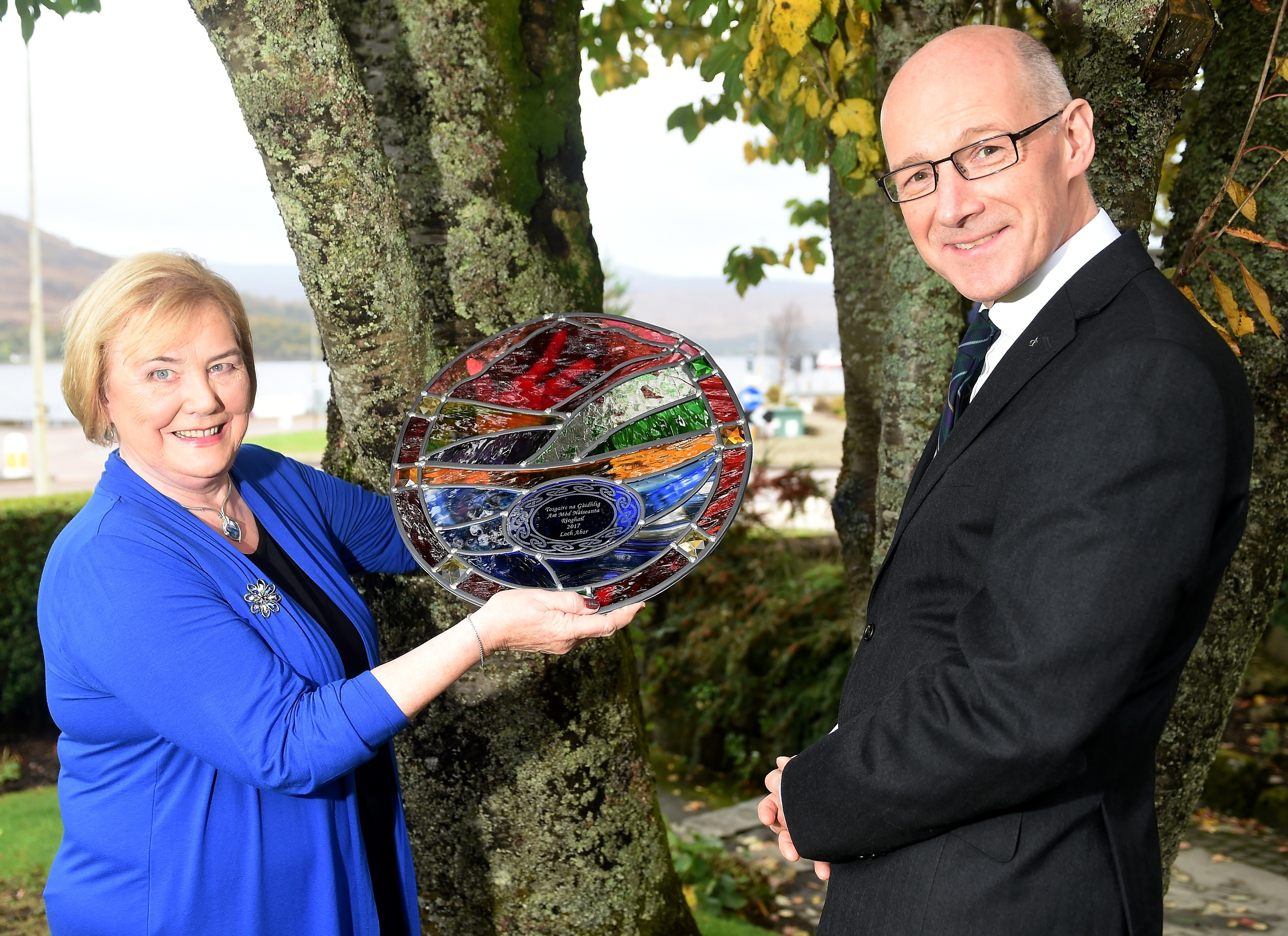 Gaelic Ambassador of the Year, Janet MacDonald of Tobermory, Mull with her award presented last night in Fort William. Also in the photograph is Deputy First Minister John Swinney. Picture by Sandy McCook
