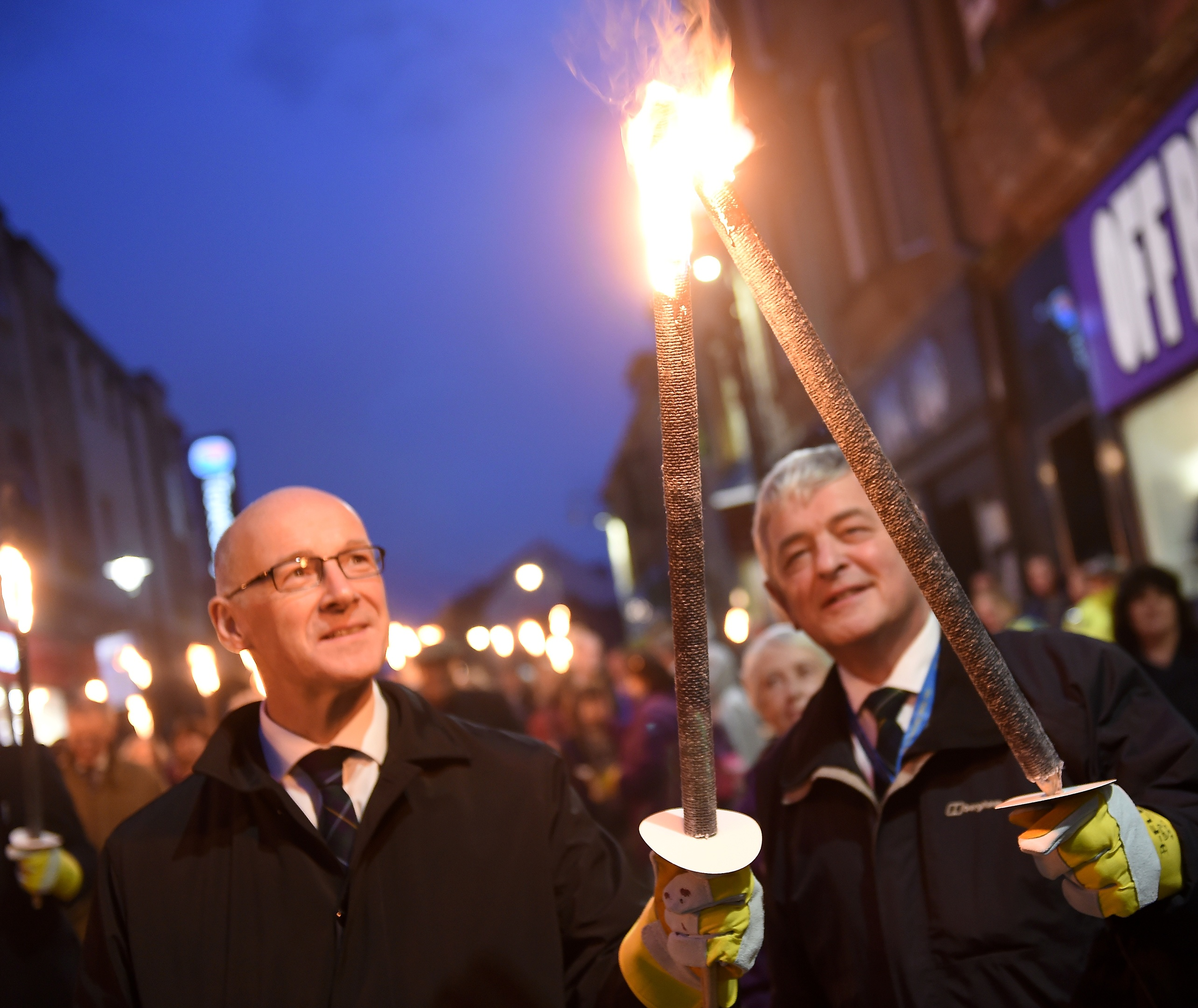 Deputy First Minister John Swinney and President Alan Campbell at the torch procession. Pic by Sandy McCook
