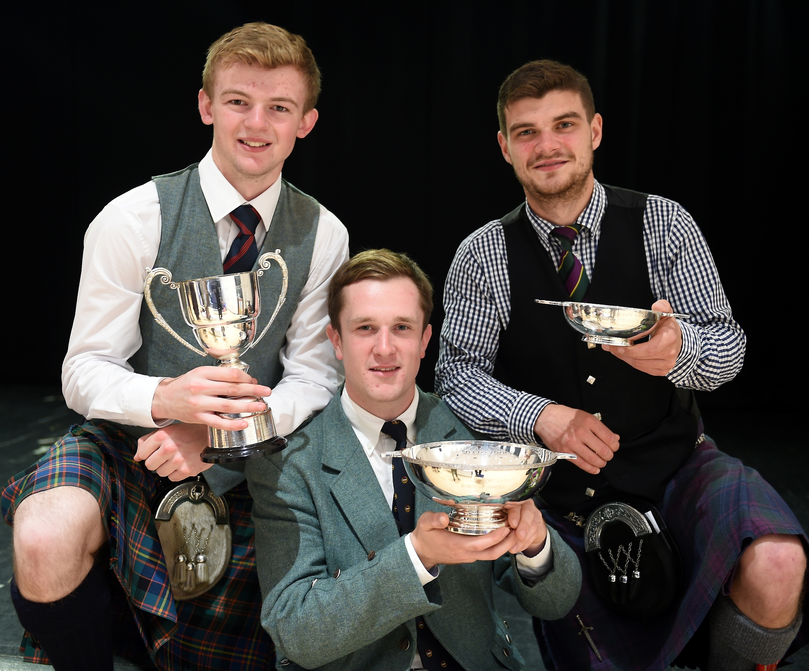 Three winners in the adult piping classes, (L-R) Sandy Cameron of Roy Bridge with the John T. MacRae Cup for the March, Strathspey and Reel; Charles Macdonald of Inverness with the James R. Johnston Memorial Trophy for Piobaireachd and Angus MacColl of Benderloch with the Argyllshire Gathering Quaich for the Hornpipe and Jig competition in Lochaber High School.