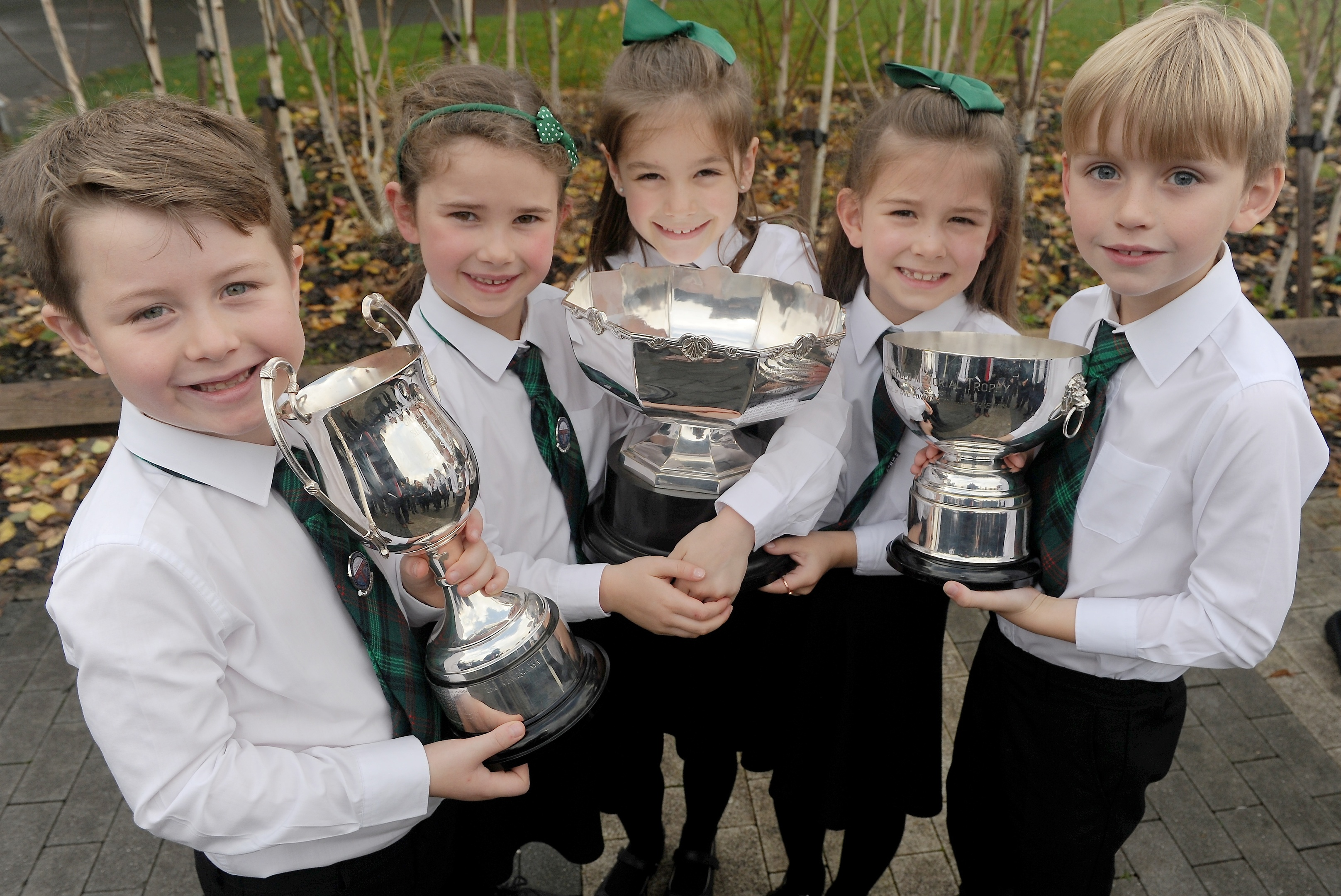 Rionnagan Rois from Ross-shire with their three trophies for Choral Singing. (L-R)Five  members of the choir  Alisdair Gordon, Morag Ross, Alex Goodall, Sophie Stewart and Ruairidh Somerville with the trophies won by the entire choir.