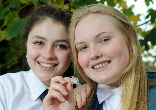Alice Nic a'Mhaoilein of the Nicholson Institute, Stornoway (right), winner of the An Comunn Gaidhealach Silver medal for solo singing with runner up Peigi Barker (left) of Fortrose Academy. Picture by Sandy McCook.