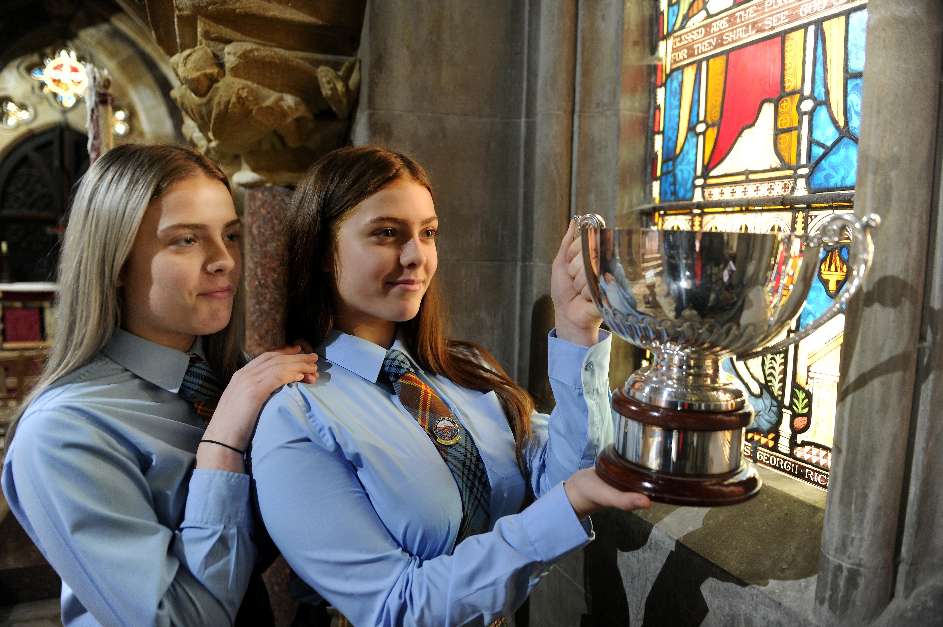 Twins Holly (left) and Lucy Smith of Falkirk and whose family all come from Barra with the McTavishs Kitchen Trophy for Duet Singing.  Picture and video by Sandy McCook.