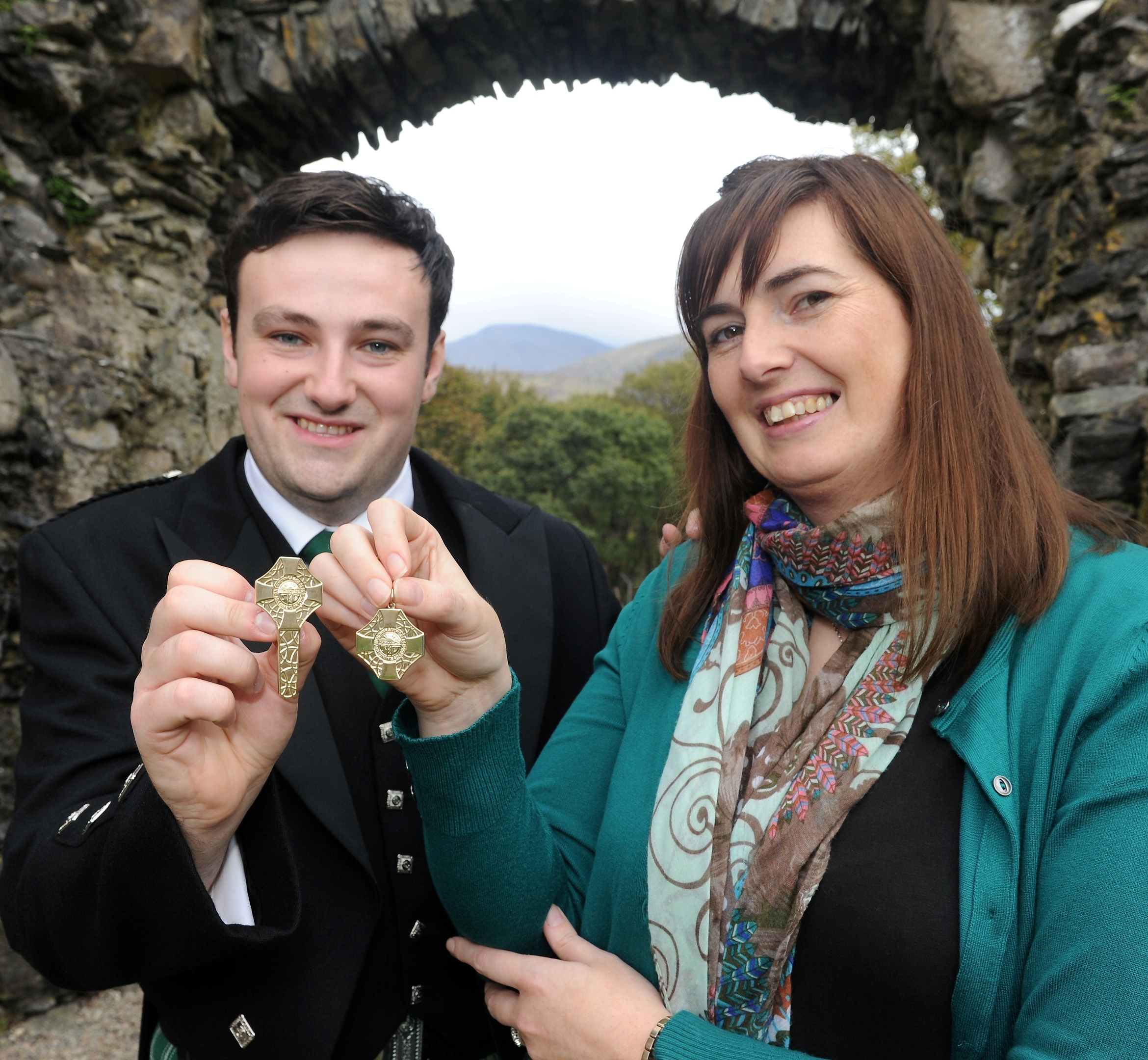 Alasdair MacMuirich of Islay and Rachel Walker of Gairlochy, Lochaber photographed with their awards yesterday in Fort William. Picture by Sandy McCook.