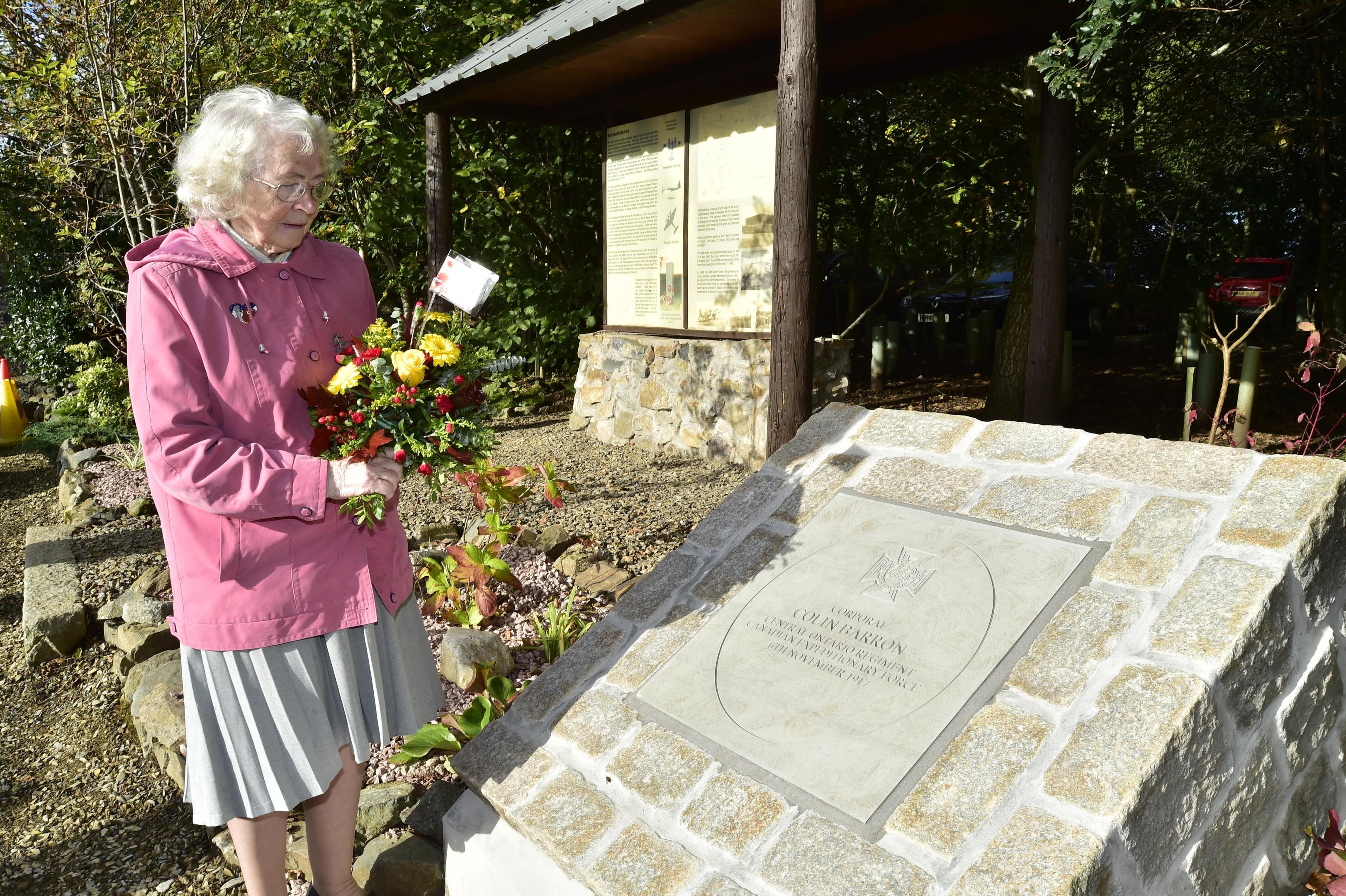 Colin Barron's niece, Daisy Ogg, beside the memorial.