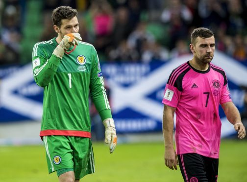 Dejection for Scotland's Craig Gordon (left) and James McArthur at full-time