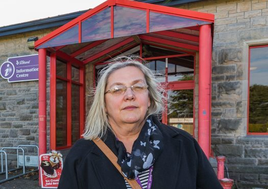 Suzanne Wright, branch secretary of Moray Unison, outside Elgin Library.