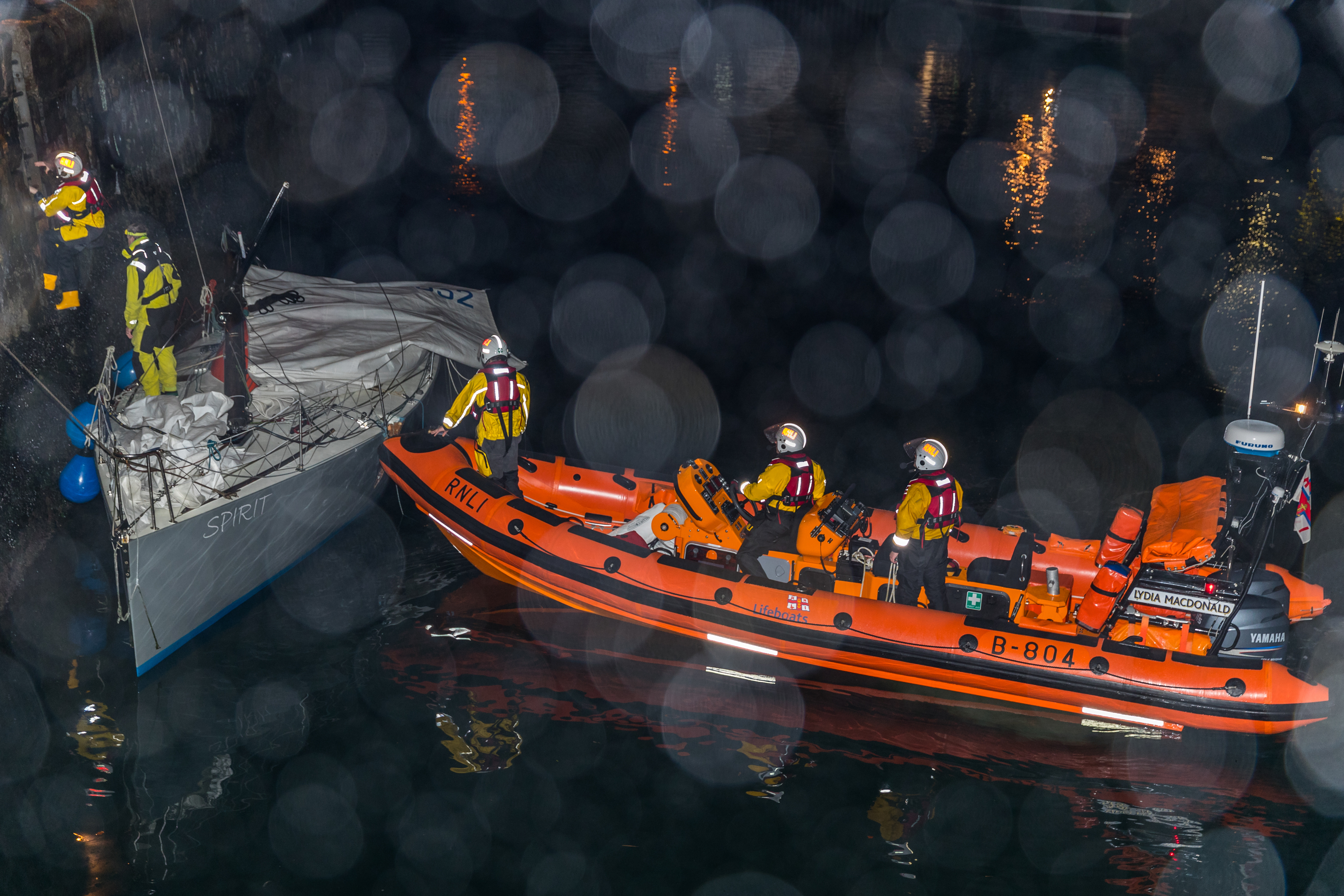 Yacht Spirit being manouvered into bertth by the Lifeboat Crew and the Sea Helper at Macduff Harbour.