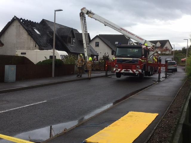 Firefighters at the scene of the fire in Conon Bridge