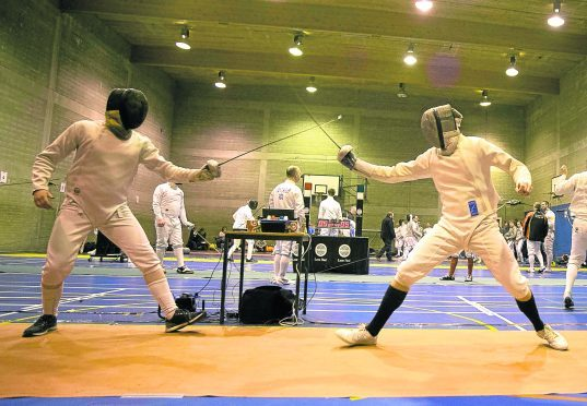 In photo on the left Kevin Linklater and Ruaridh Colclough taking part in the mens Epee Epee