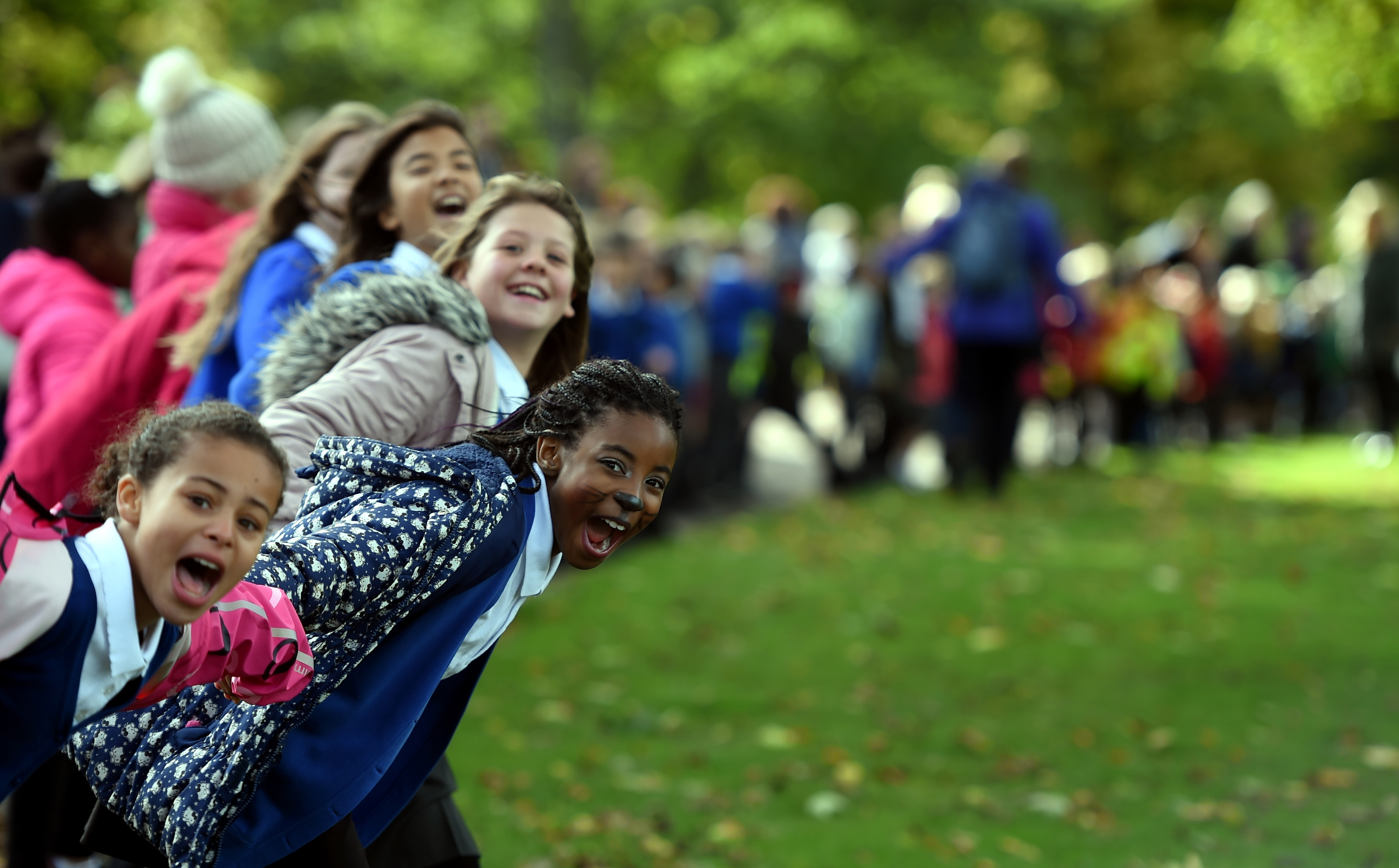 The youngsters of Ferryhill Primary School making a human chain for the Anchor Unit charity at Duthie Park, Aberdeen.  Pictures by Jim Irvine