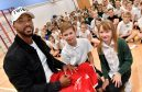 Footballer Shay Logan with Kai Muirhead and Sophie Seston (right).   Pictures by Kami Thomson.