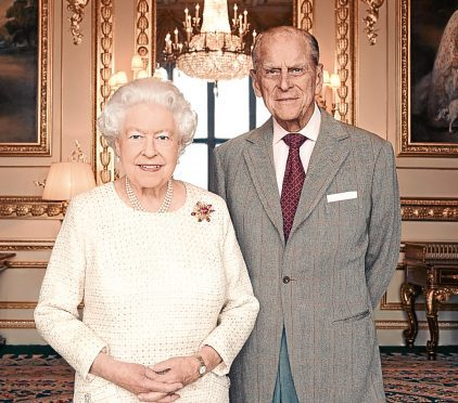 Queen Elizabeth II and the Duke of Edinburgh by British photographer Matt Holyoak, taken in the White Drawing Room at Windsor Castle in early November, in celebration of their platinum wedding anniversary on November 20.