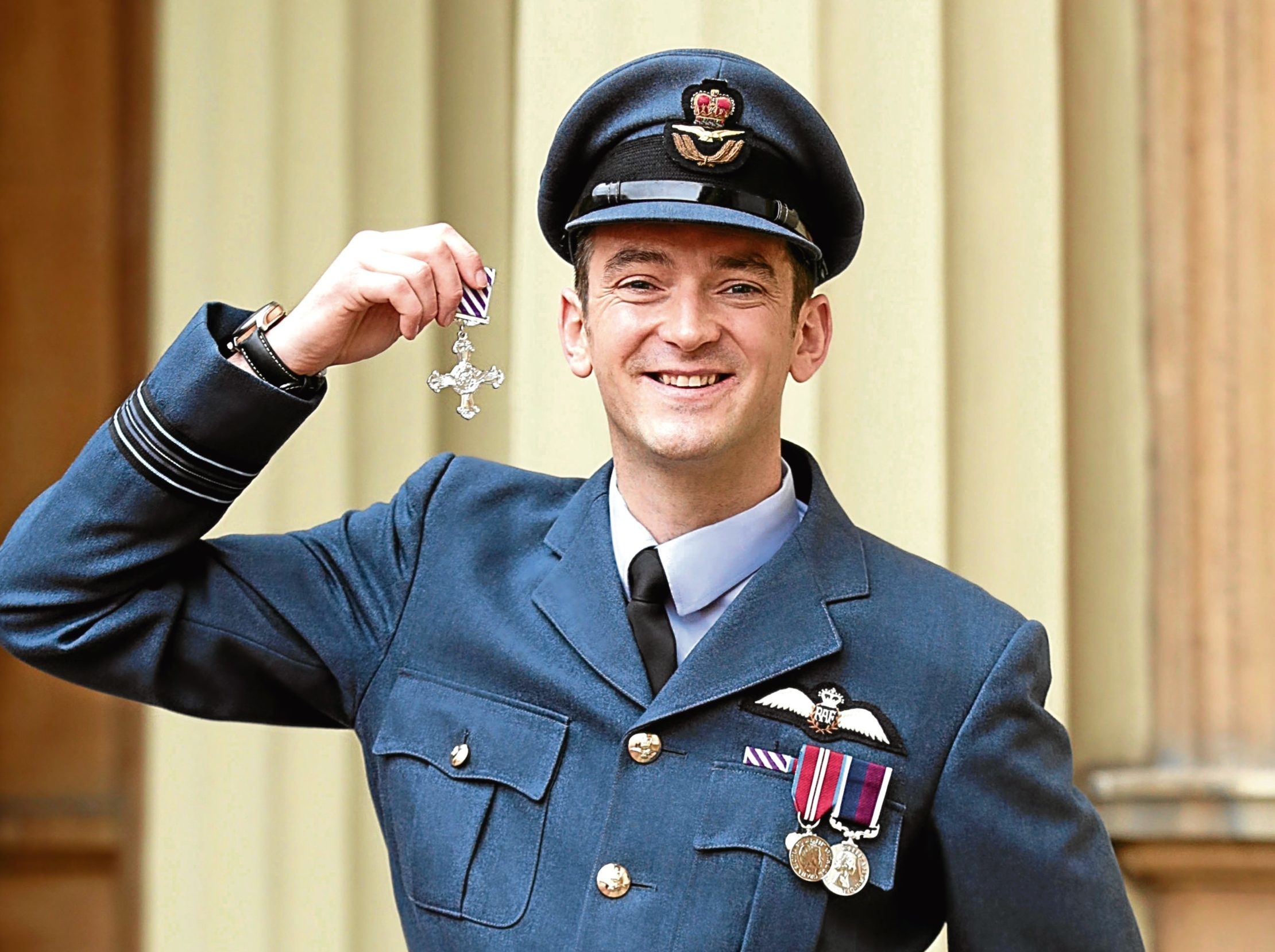 Squadron Leader Roger Cruickshank after being presented with a Distinguished Flying Cross by the Duke of Cambridge, at Buckingham Palace, London.