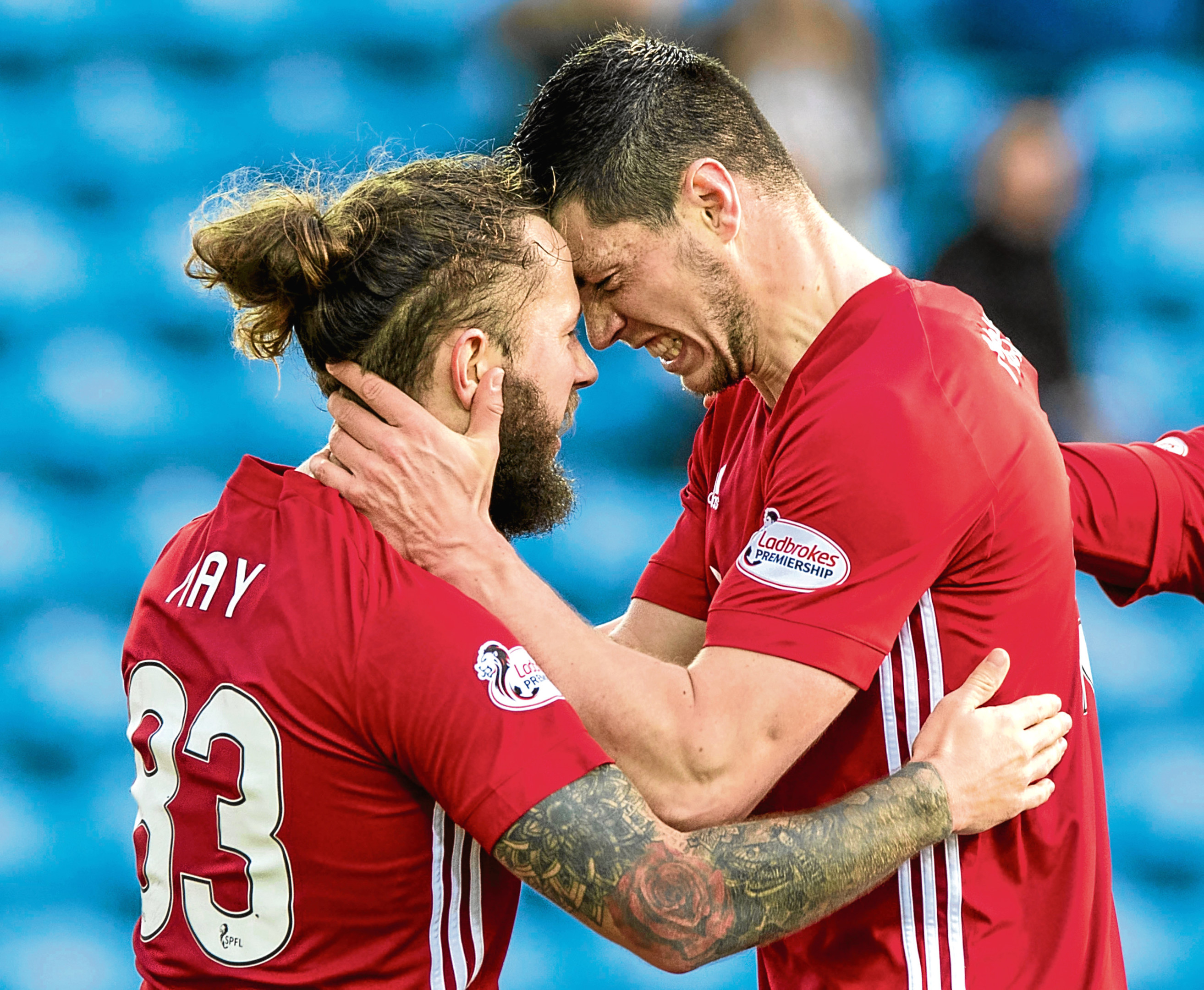 Scott McKenna (right) has been subject of two failed transfer bids from Hull City.