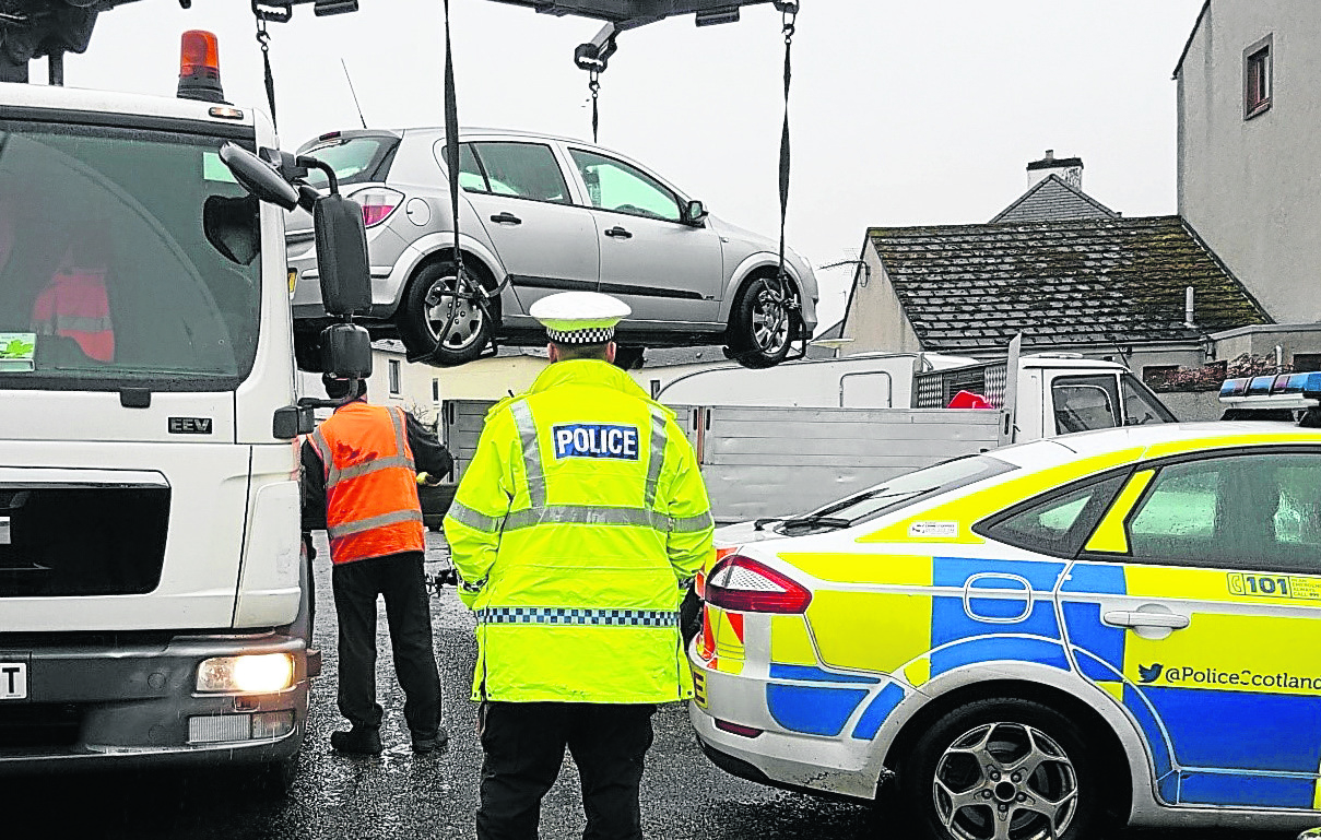Officers from Police Scotland working with a range of partner agencies to remove a number of abandoned and untaxed vehicles from the roads of the Highlands.